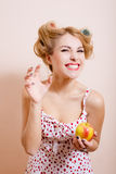 Excited happy young lady in lingerie and curlers Stock Photos