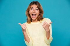 Excited happy young smiling woman showing thumbs up Stock Images