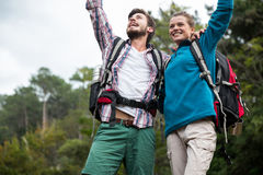 Excited hiker couple in forest Stock Images