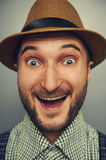 Excited hipster man in straw hat Royalty Free Stock Photography
