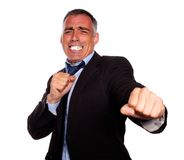 Excited hispanic business man boxing Royalty Free Stock Images