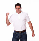 Excited hispanic man celebrating his victory Royalty Free Stock Photos