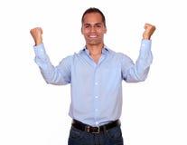 Excited hispanic man celebrating a victory Stock Image