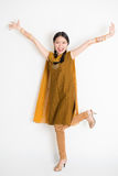 Excited Indian Chinese female arms raised Royalty Free Stock Photos
