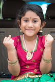Excited Indian girl sitting in car Royalty Free Stock Image