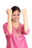 Excited Indian woman. Happy Indian woman with clenched fists isolated on white background Stock Image