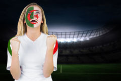 Excited iran fan in face paint cheering Royalty Free Stock Photos