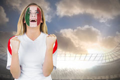 Excited italy fan in face paint cheering Royalty Free Stock Photography