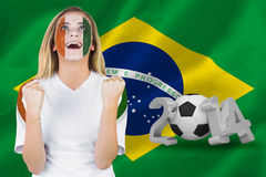 Excited ivory coast fan in face paint cheering Royalty Free Stock Images