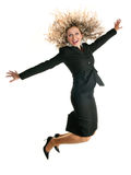 Excited jumping business woman. Overexcited young business woman jumping high with hair flying Royalty Free Stock Photo