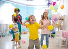 Excited kid boy on birthday party. Excited kid boy playing with balloons on birthday party royalty free stock photos