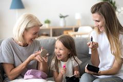 Free Excited Kid Girl Holding Lipstick Doing Makeup With Mom Grandma Royalty Free Stock Photography - 131816607