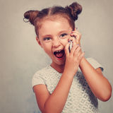 Excited Kid Girl Talking On Mobile Phone With Opened Mouth On Bl Stock Photos