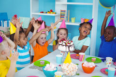 Excited kids enjoying a birthday party Royalty Free Stock Image