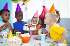 Excited kids enjoying a birthday party Stock Image