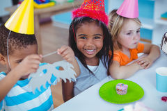 Excited kids enjoying a birthday party Stock Photos