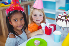 Excited kids enjoying a birthday party Royalty Free Stock Photography