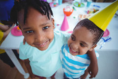 Excited kids enjoying a birthday party Royalty Free Stock Photos