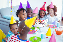 Excited kids enjoying a birthday party Royalty Free Stock Images
