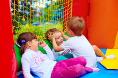 Excited kids having fun on inflatable attraction playground Royalty Free Stock Images