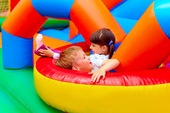 Excited kids having fun on inflatable attraction playground Stock Photography