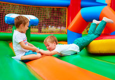 Excited kids having fun on inflatable attraction playground Royalty Free Stock Photo