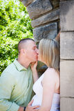 Excited Kissing Couple Expecting Baby Royalty Free Stock Image