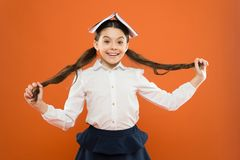 Excited about knowledge. Life balance and positivity. Everything is under control. Dealing with school stress. Girl. Child hold book. School girl studying royalty free stock images