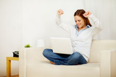 Excited lady celebrating a victory on laptop Royalty Free Stock Photos
