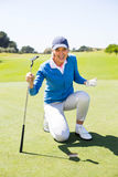 Excited lady golfer cheering on putting green. On a sunny day at the golf course Royalty Free Stock Images