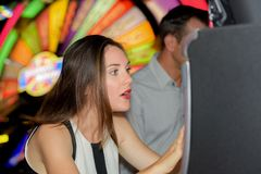 Excited lady playing arcade game royalty free stock photo