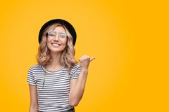 Excited lady pointing aside royalty free stock image
