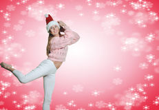 Excited lady in Santa hat jumping up on pink Stock Image