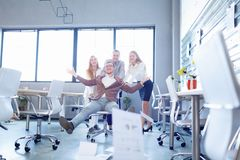 Excited office people throwing papers on a room background. Business achievement concept. stock images