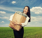 Excited laughing woman with money Stock Photography