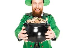 Excited leprechaun in green suit looking at pot of gold. Isolated on white Royalty Free Stock Photography