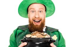 Excited leprechaun holding pot of gold. Isolated on white Stock Photos