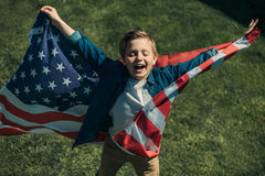 Excited little boy with american flag Royalty Free Stock Image