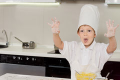 Excited little boy doing the baking Royalty Free Stock Image