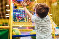 Excited little boy having fun. At the entertainment centre Stock Photography