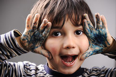 Excited little boy with messy color Royalty Free Stock Photos