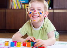 Excited little boy painting. With colorful paints Stock Photography