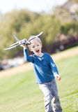 Child playing with a plane Royalty Free Stock Photo