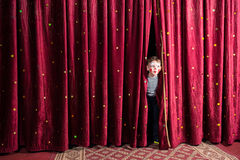 Excited little boy on stage Stock Image