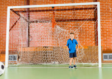 Excited little boy standing in the goalposts Stock Photography