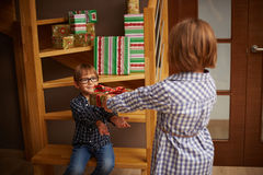Excited little boy taking a gift from his sister Royalty Free Stock Photography