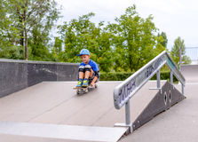 Excited little boy trying out his new skateboard Stock Images