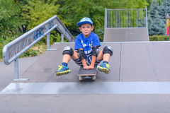 Excited little boy trying out his new skateboard Royalty Free Stock Photos