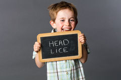 Excited little child warning about head lice to fight against Royalty Free Stock Images