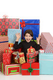 Excited little girl with christmas presents Stock Image